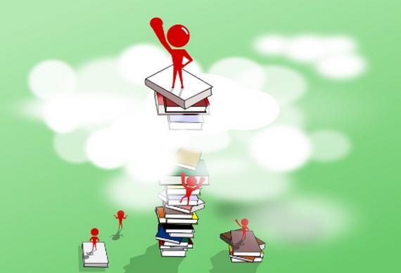 本の上に乗った人形イラスト